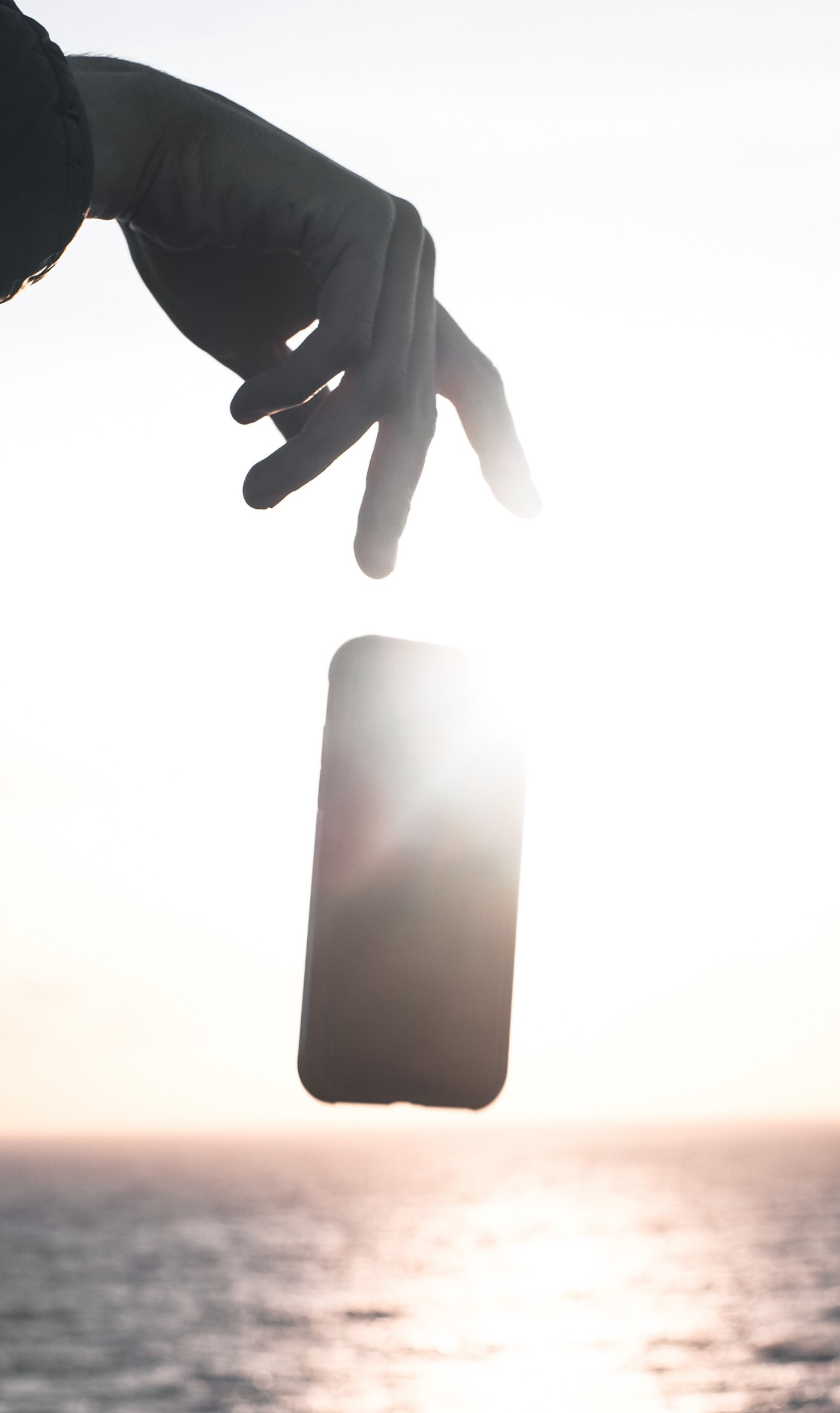 someone dropped a cellphone into water under sunshine
