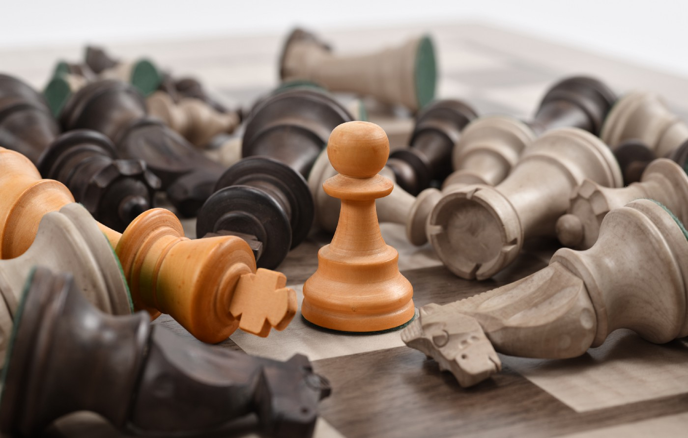 Chess board with a white pawn in focus