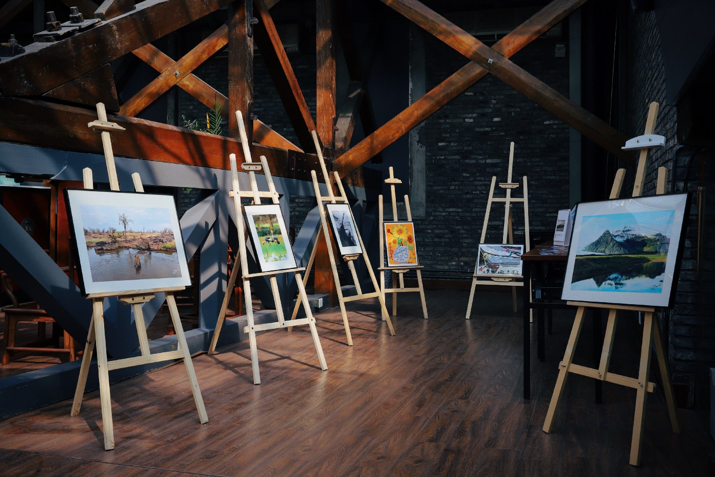 six paintings displayed on easels