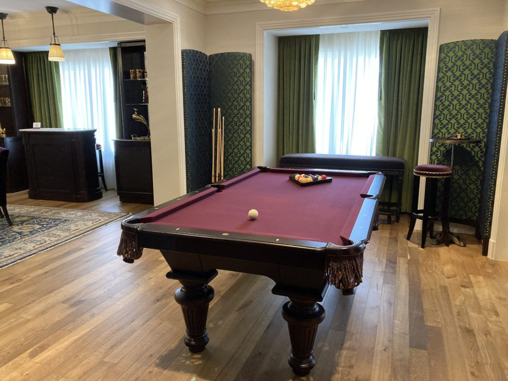 a pool table in a NoMad Suite Royal Premiere