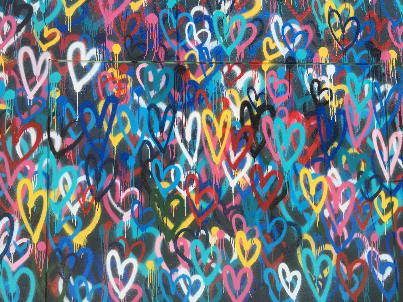 A painting with different colored hearts