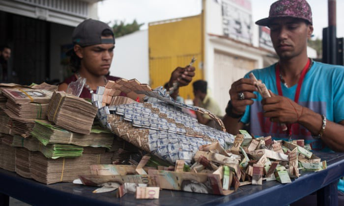 Venezuelans using their currency to make origami