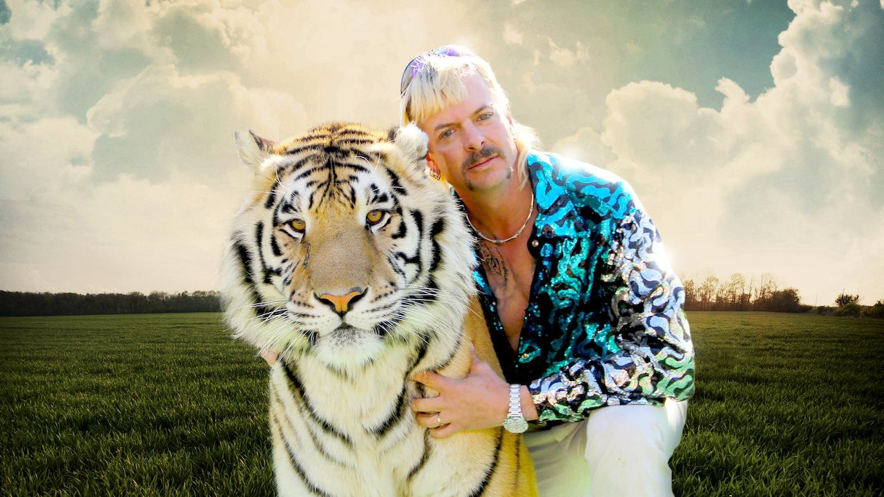 A promo still from Tiger King showing Joe Exotic with a tiger.