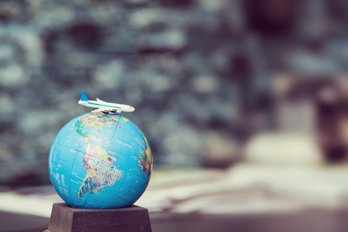Miniature globe with a model airplane on top