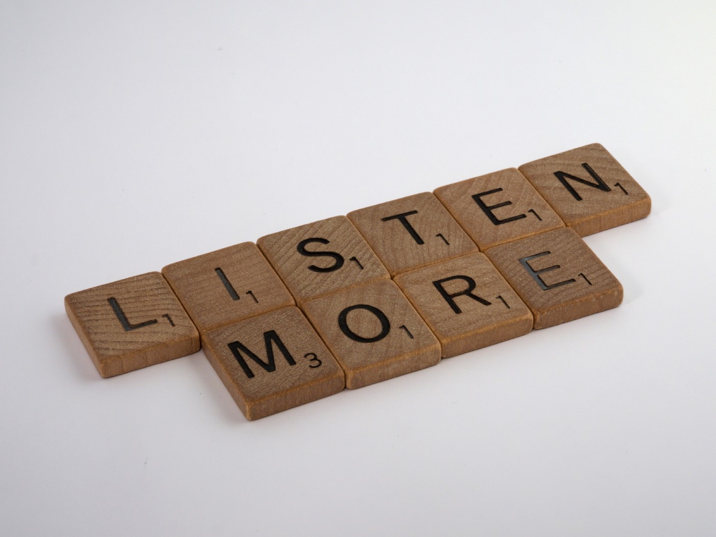 Picture with scrabble blocks saying 'Listen More'