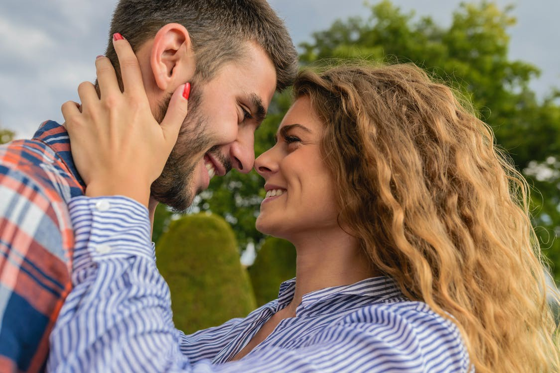A couple puts their faces together, smiling at each other. The woman holds the man's head in her hands. #couple #happycouple #relationship #healthyrelationship #love #dating