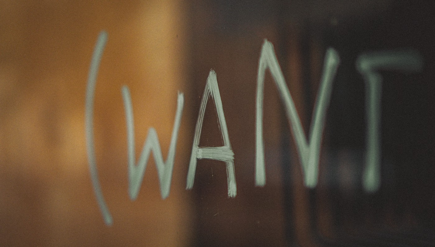 hand painted sign with the word WANT