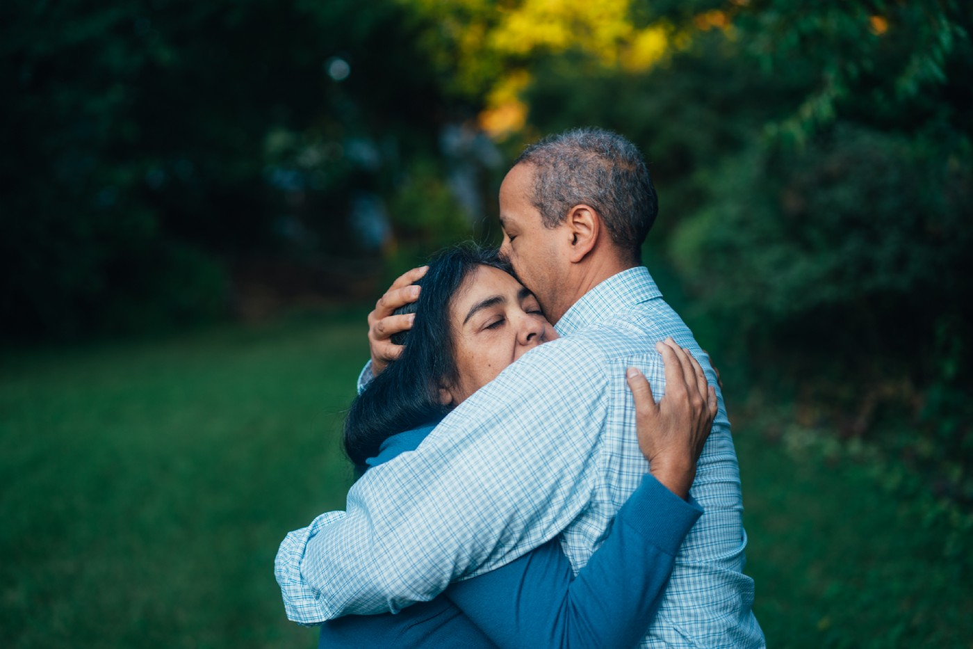 A man is hugging a woman