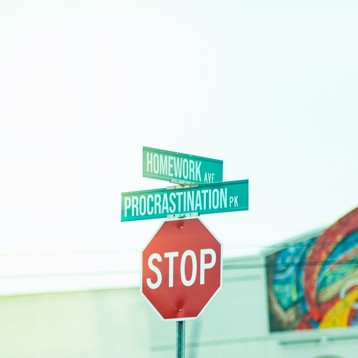 """Stop sign at an intersection, featuring additional street signs that say, """"Homework Avenue"""" and """"Procrastination Park."""""""