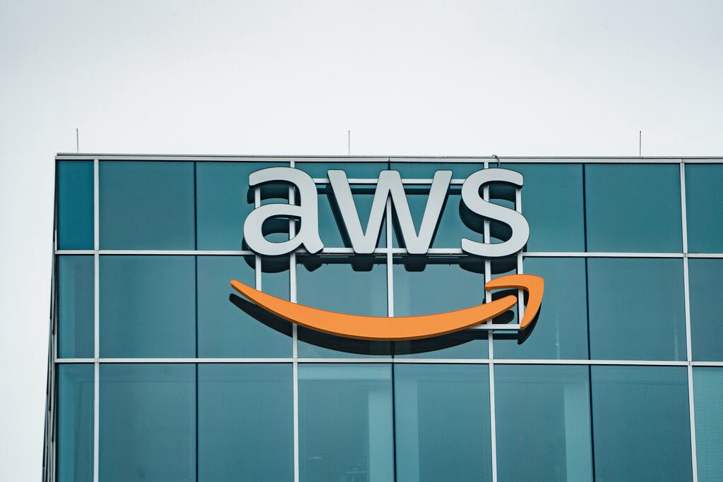 aws logo on dark grey office building windows