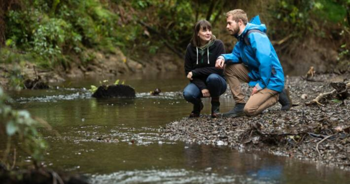 Marnie from Choose Clean Water next to a stream with a friend