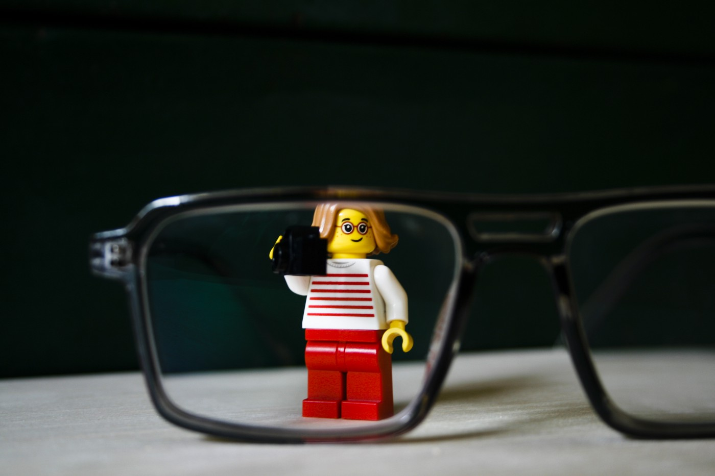 Figurine standing behind glasses