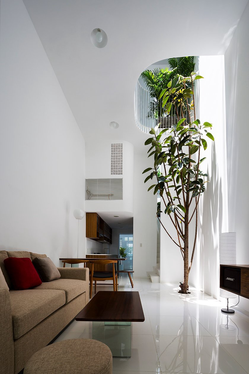 At ground level the house is almost five times as long as it is wide; to the rear, it opens up to reveal a light and airy double-height living room. (Photos: Hiroyuki Oki)