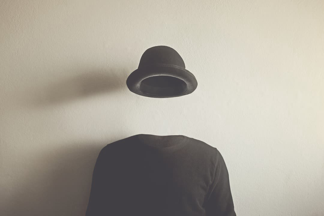 Invisible man showing only the hat and clothed body.