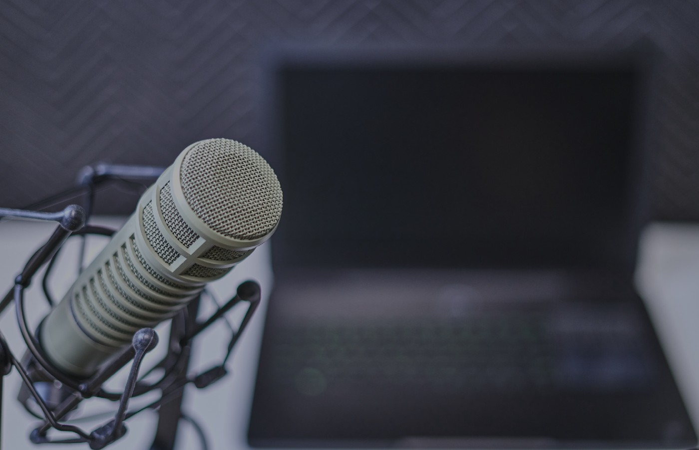 Microphone in front of an open laptop