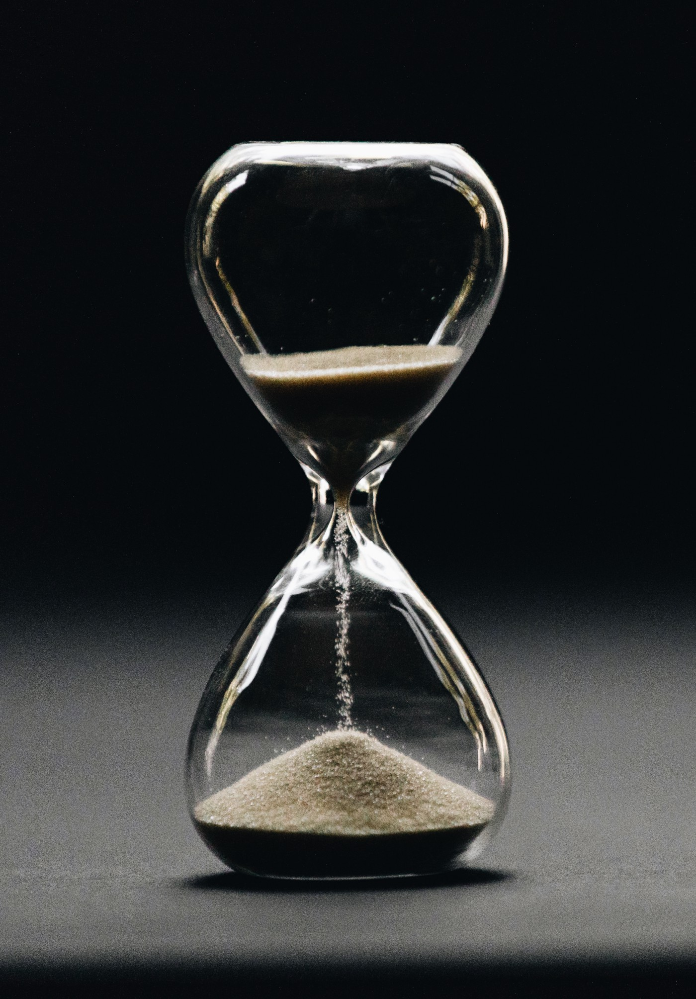 An hour-glass in motion for time management