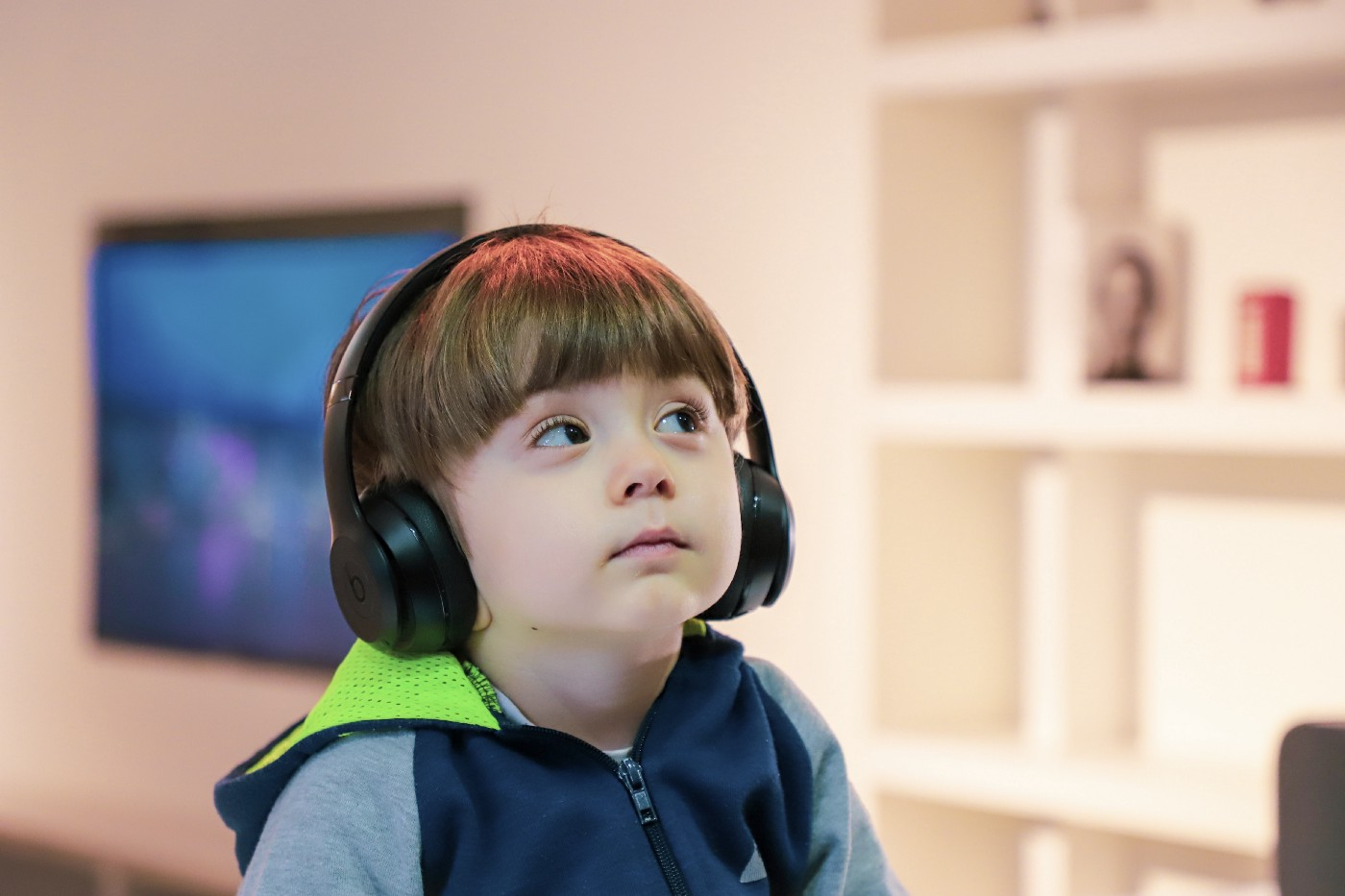 Young child wearing oversized bose headphones