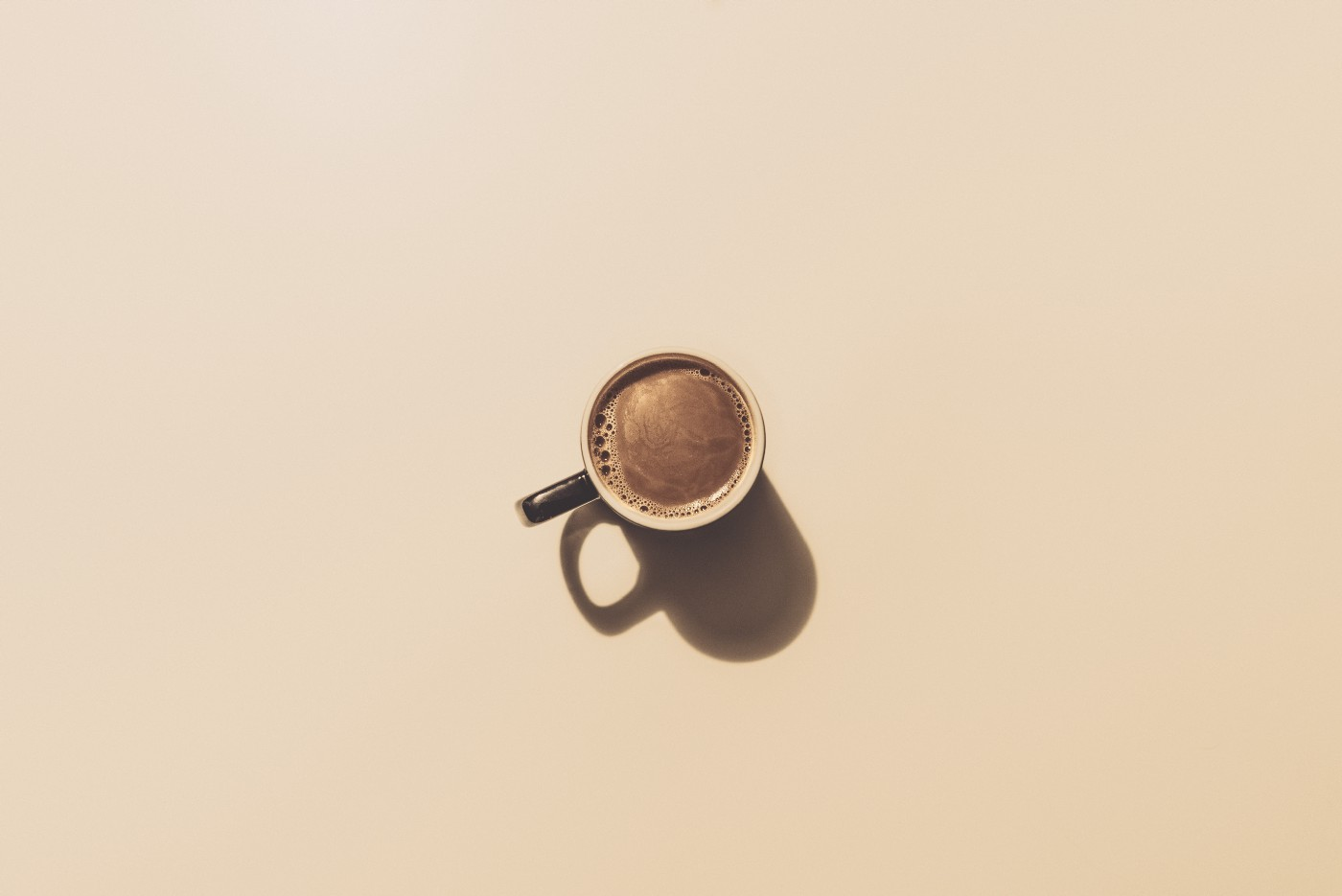 Cup of coffee on an empty table