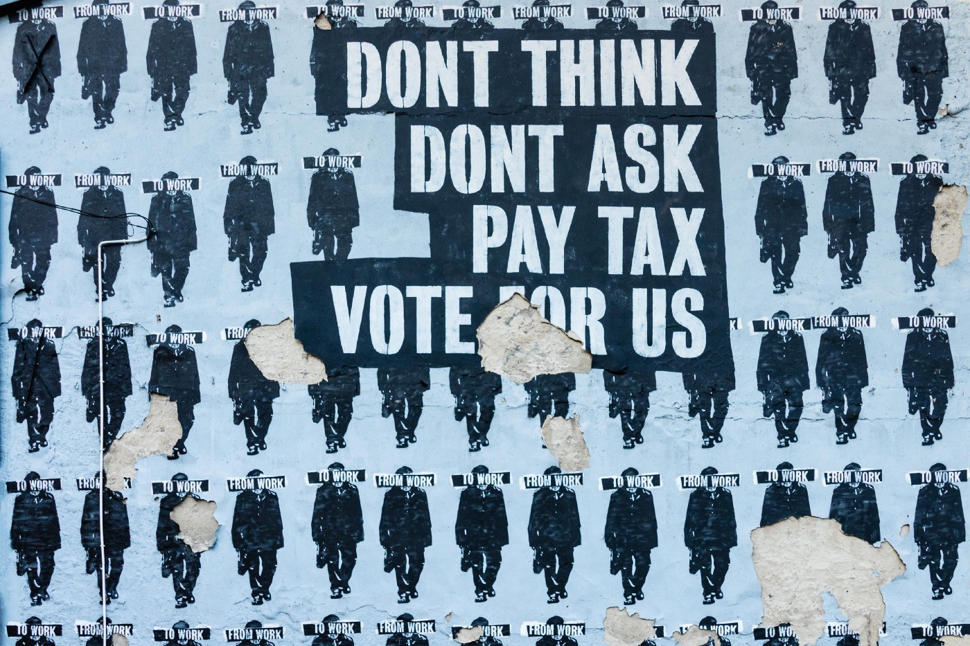 "Blue and black street art that reads ""don't think don't ask pay tax vote for us"""