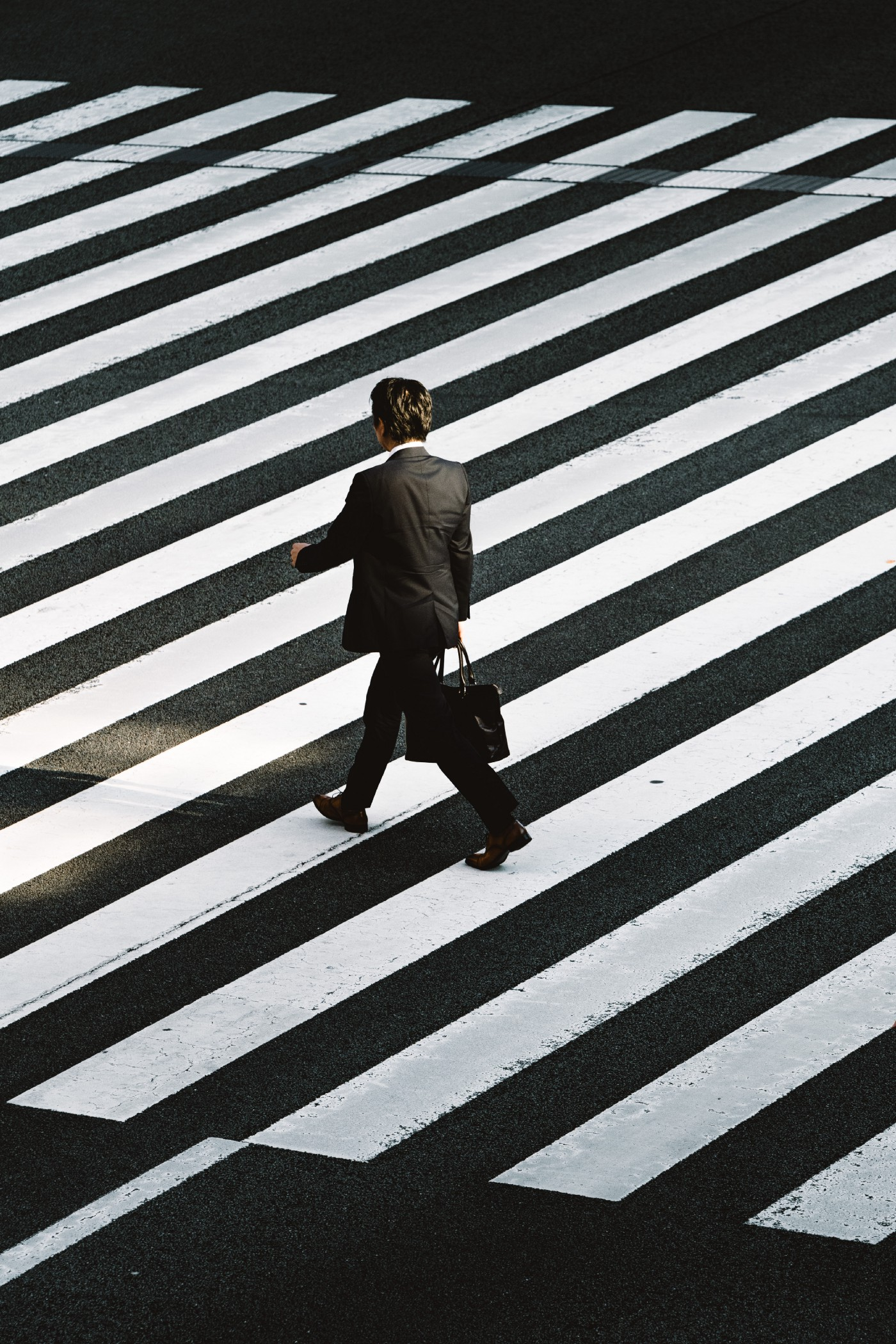 businessman crossing the street—black and white photo