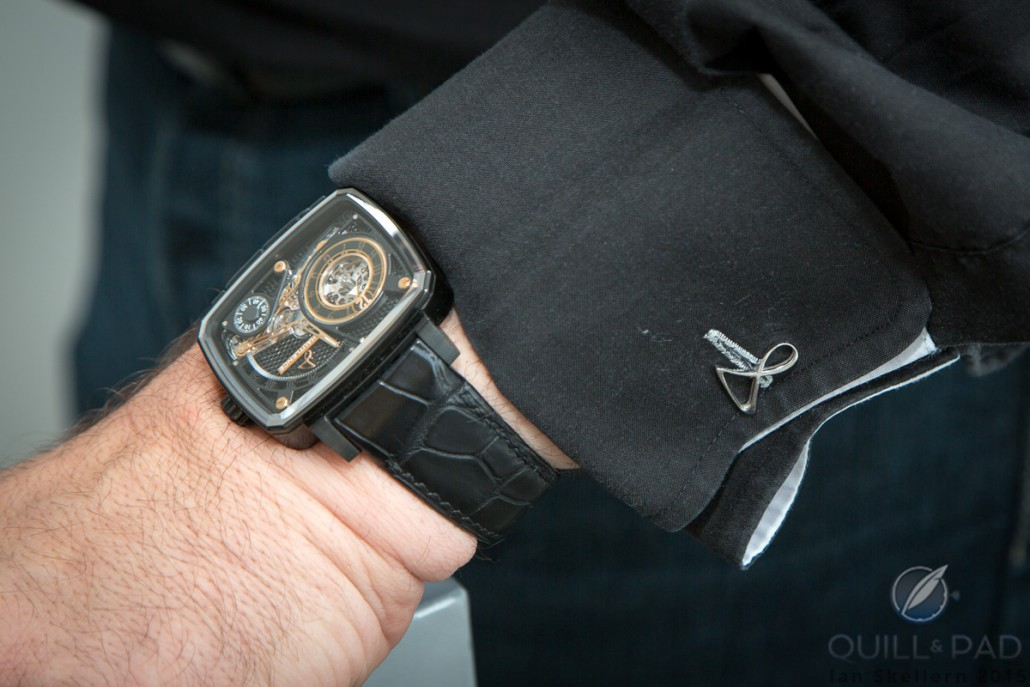Hautlence HL Black Ceramic on the wrist of brand co-founder and CEO Guillaume Tetu. Nice cuff links in the form of the Hautlence logo