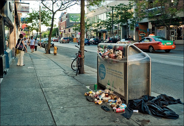overflowing trash container in streets of Toronto