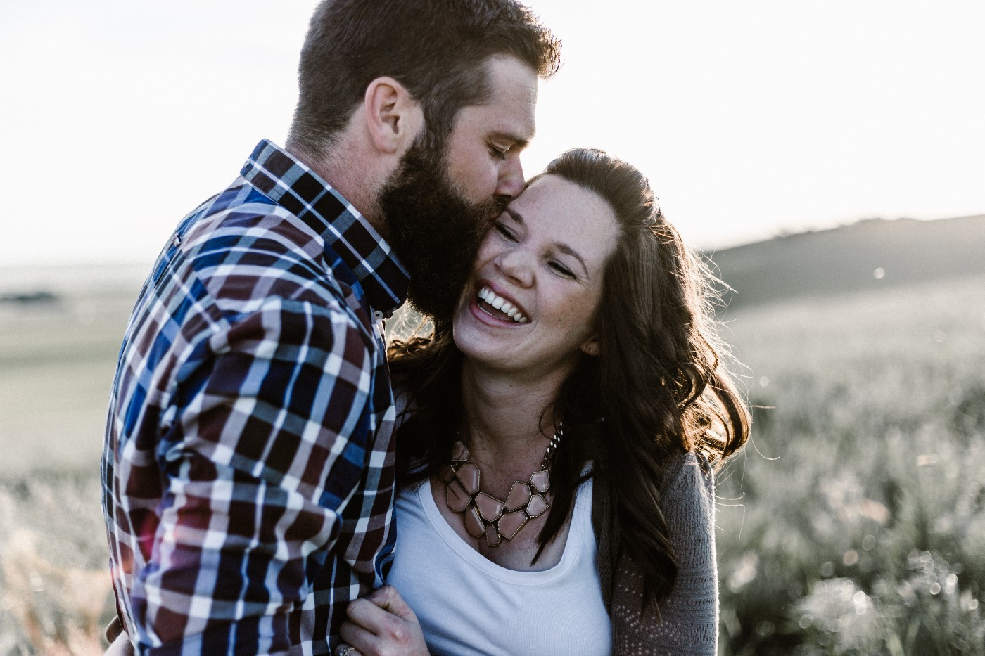 Couple embracing and laughing.