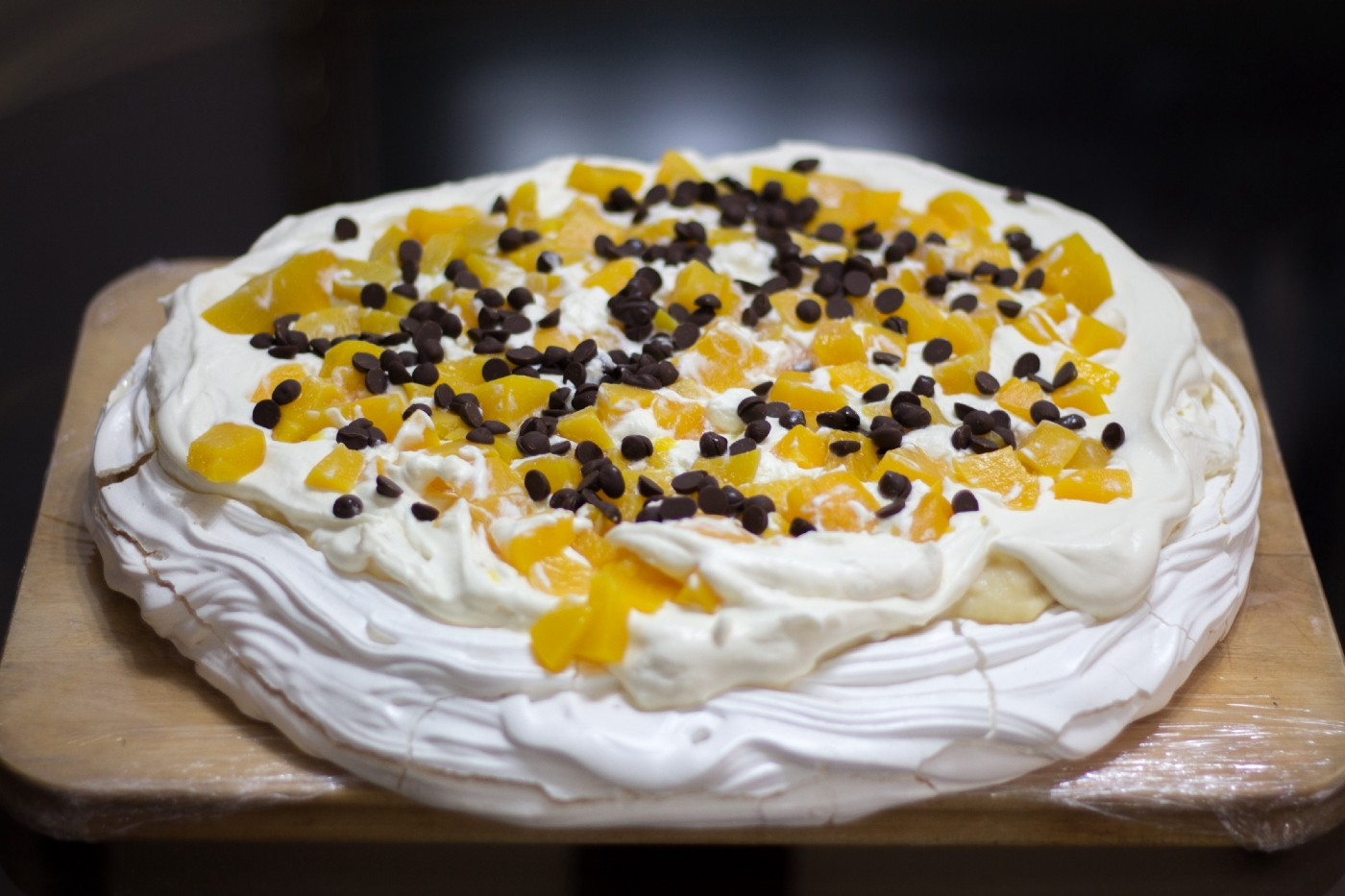 A delicious dessert of meringue topped with whipped cream and fruit. (This one has chocolate too —a step too far!)