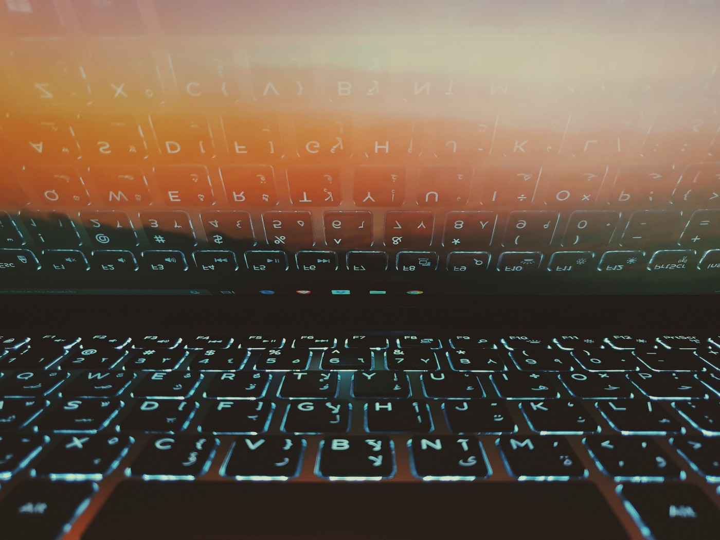 Keyboard and keyboard reflexion on the laptop screen
