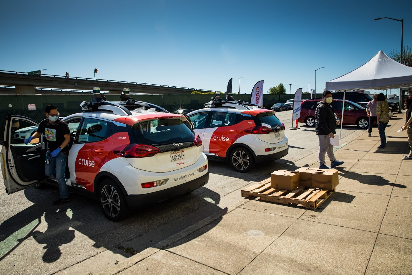 Cruise volunteers their all-electric, self-driving fleet to deliver meals and groceries in San Francisco.