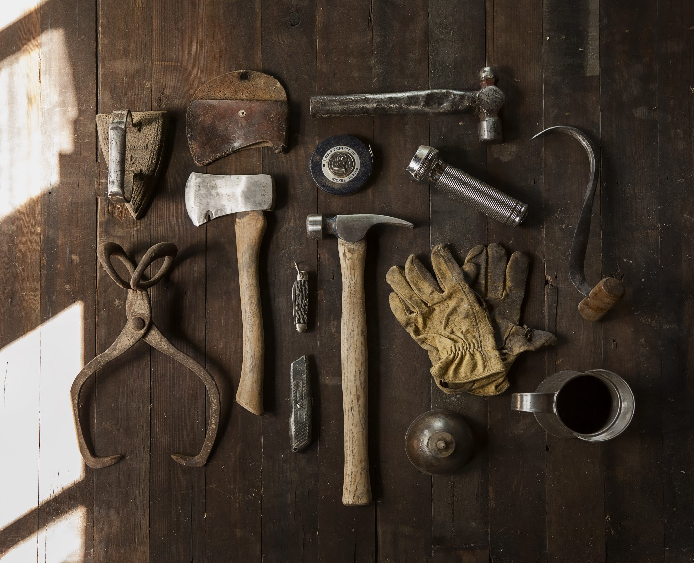 A selection of tools on a wooden surface