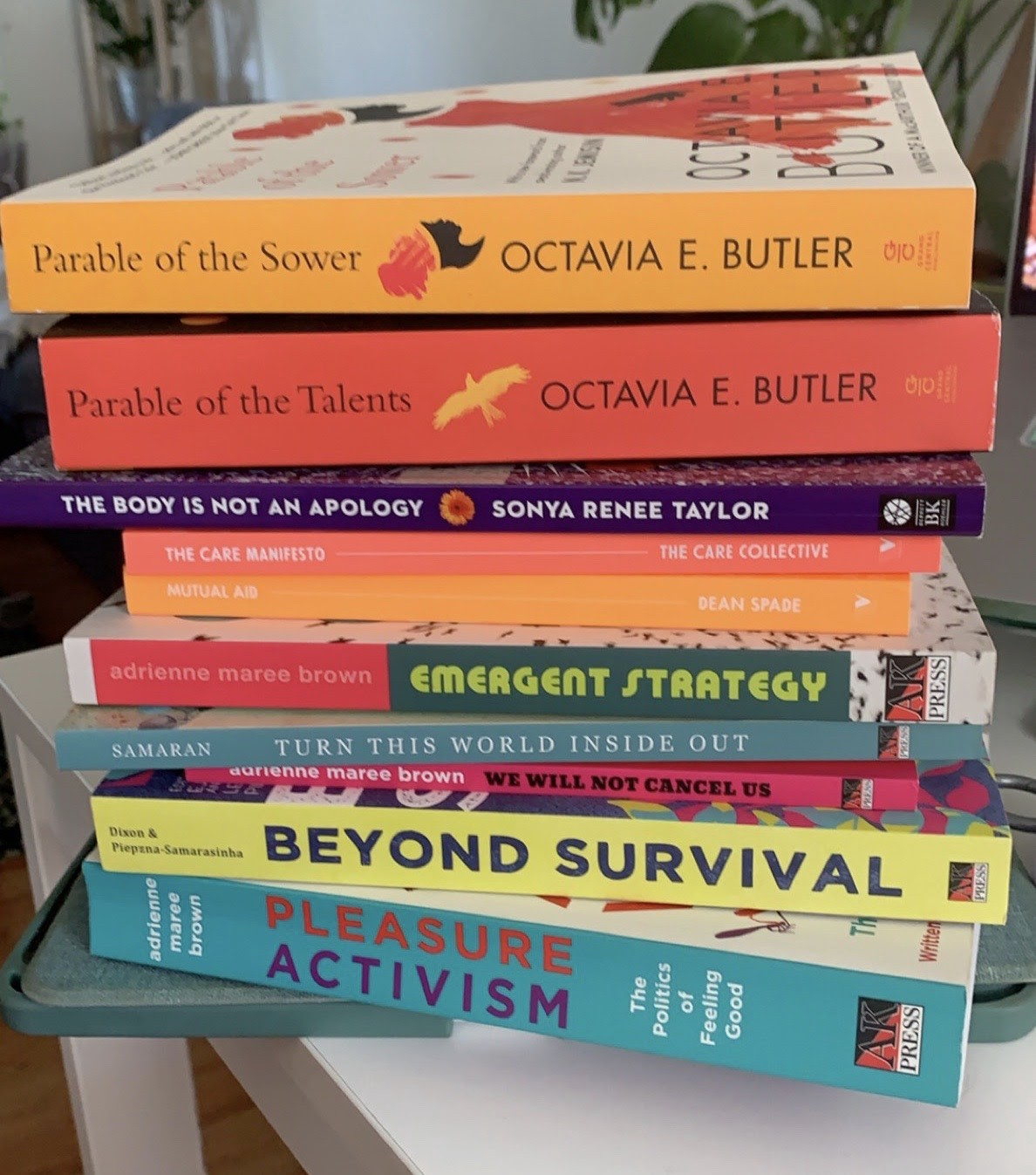 A stack of books, included in this reading list, from my personal collection.