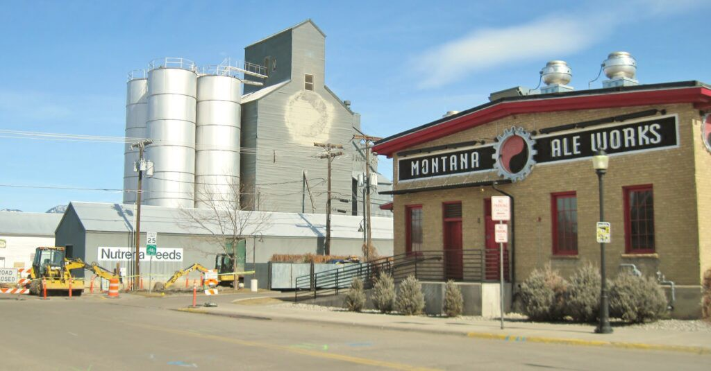 Yellow building with red details, sign that reads Montana Ale Works