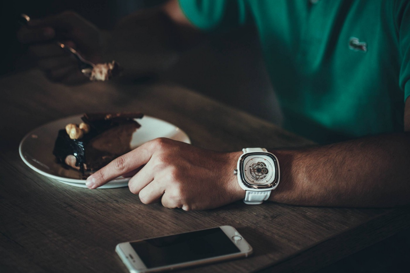 Person eating while wearing a wristwatch.