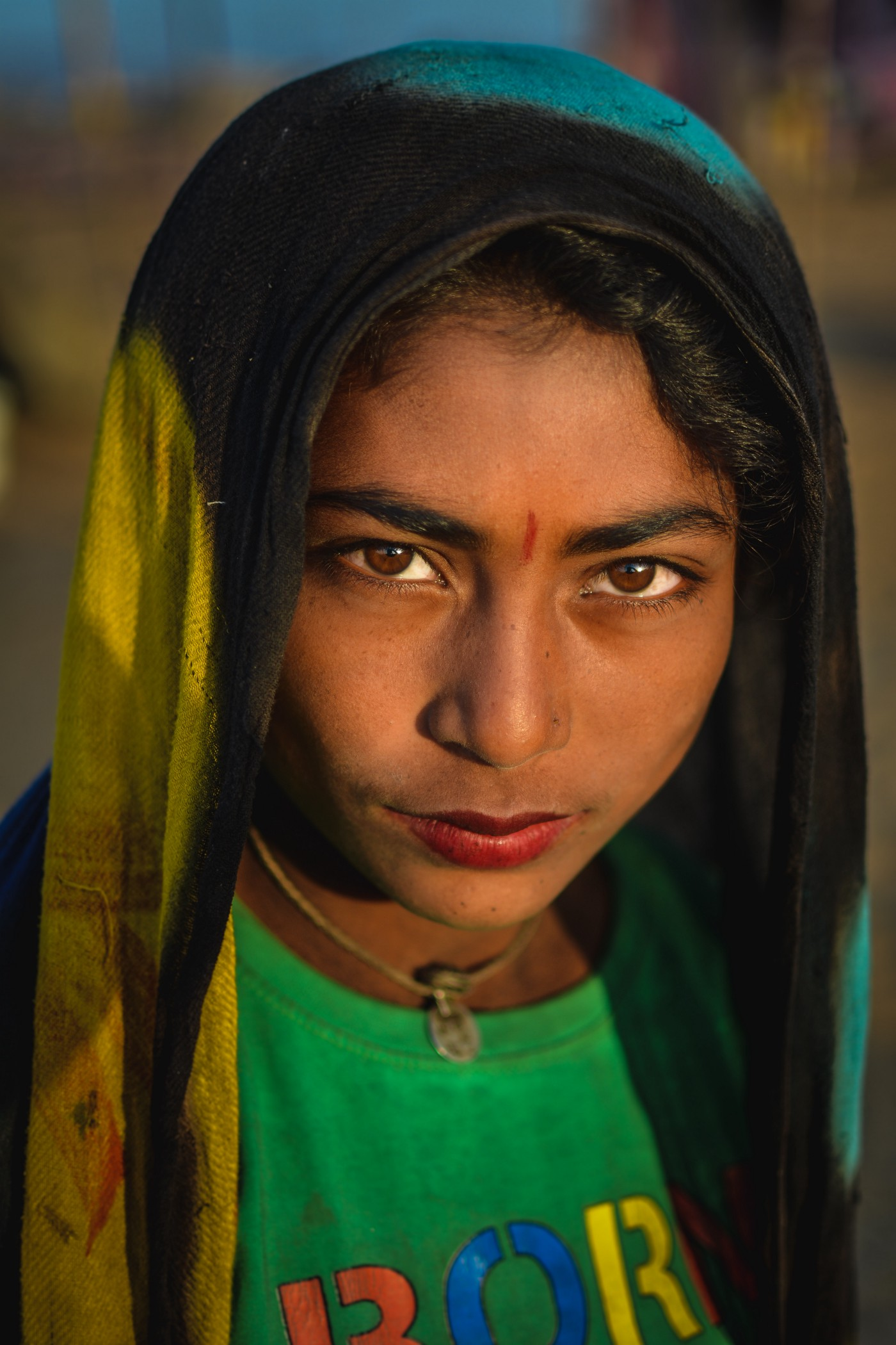 An Indian girl with a bindi on her fore-head and a veil on her head