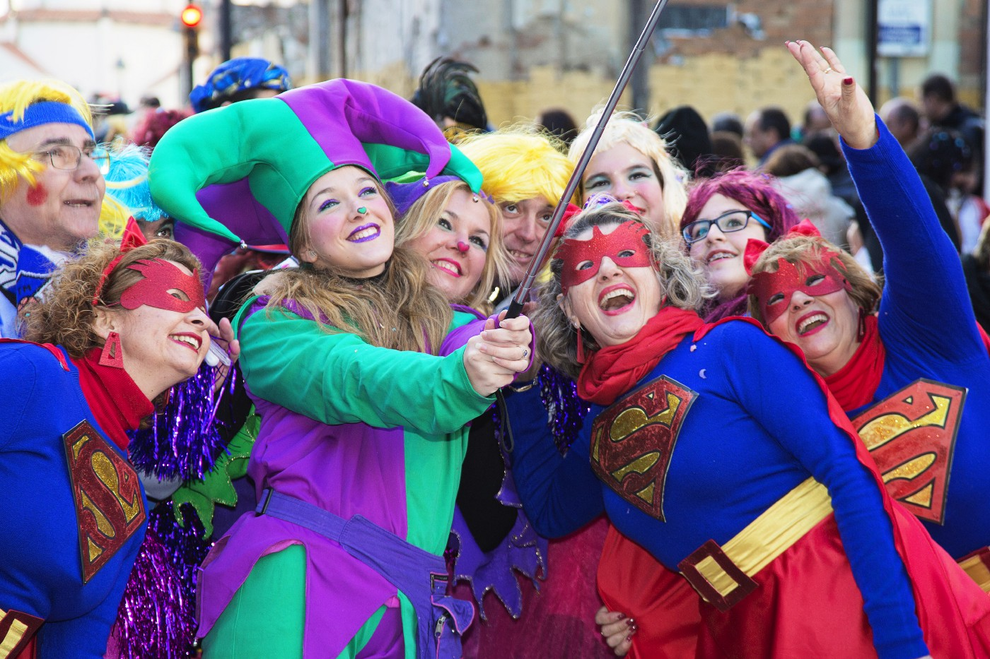 the image is that of a crowd of people dressed in superhero costumes. The most popular one being worn is Supergirl's.