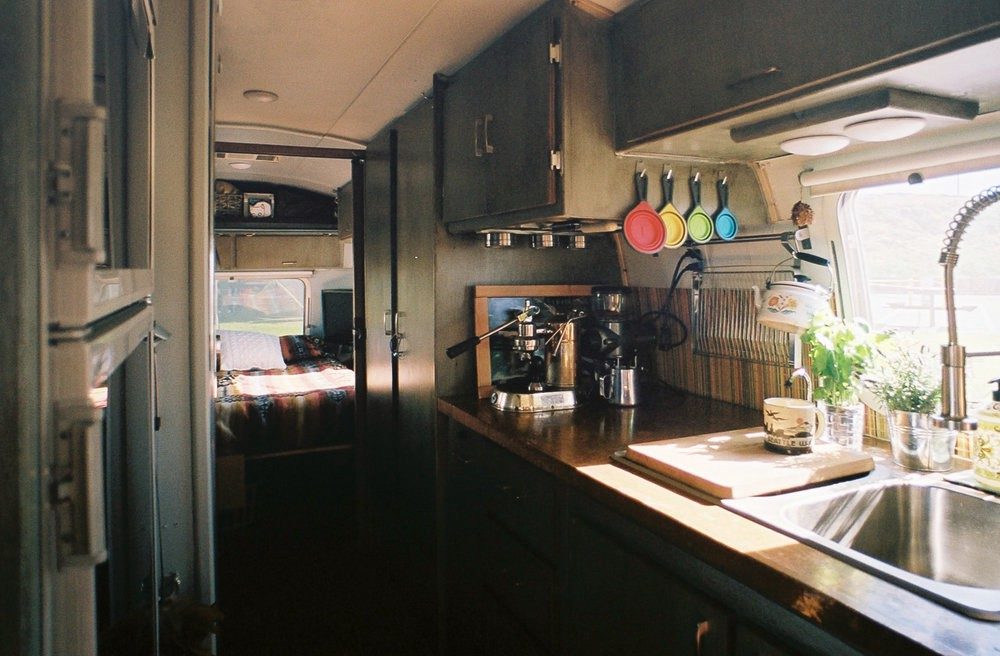 Kitchen view from the left down the hall to our bedroom. Our countertops are copper which is naturally antimicrobial, and looks different every day.