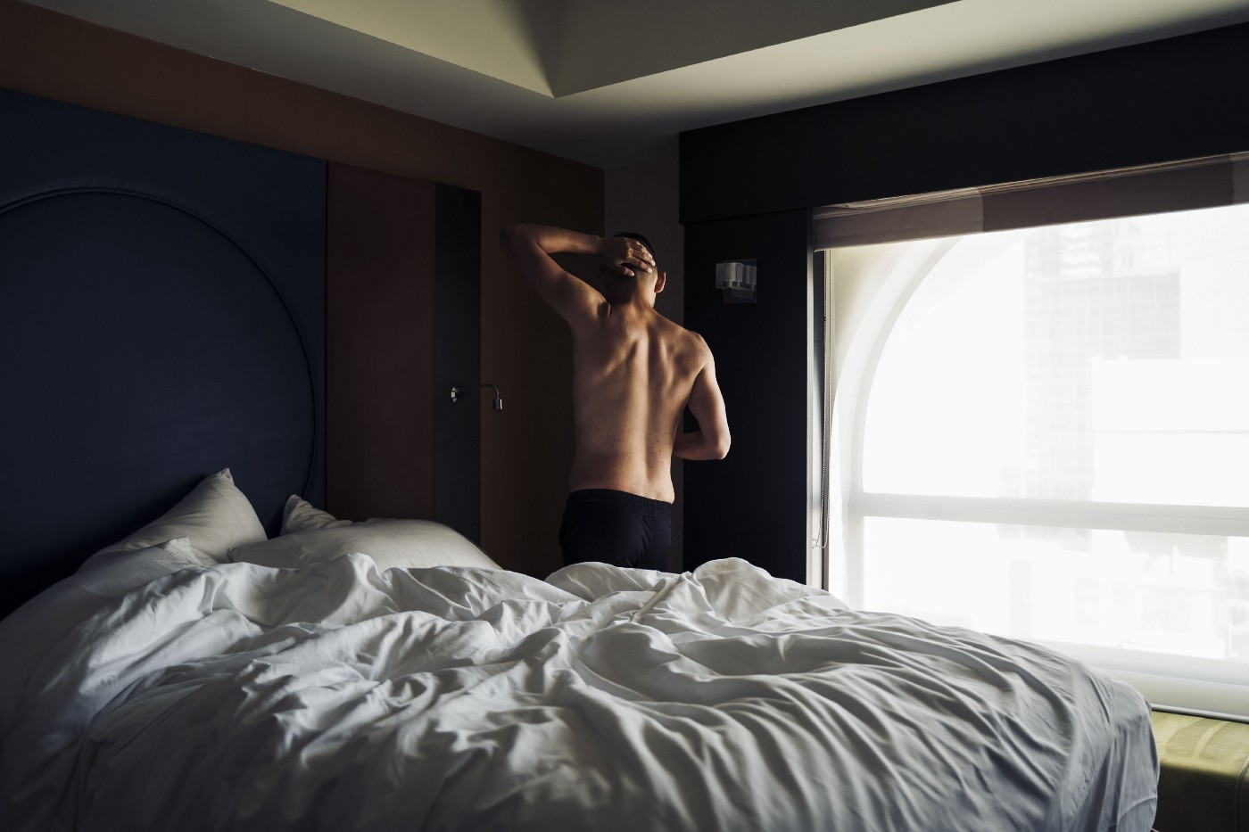 Guy getting out of bed