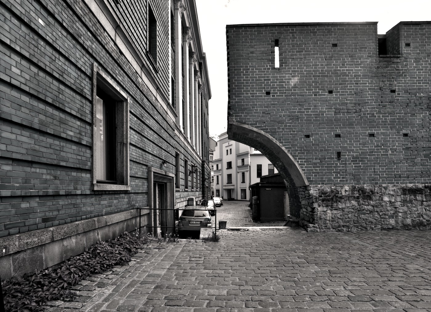 Image of half an archway close to housing
