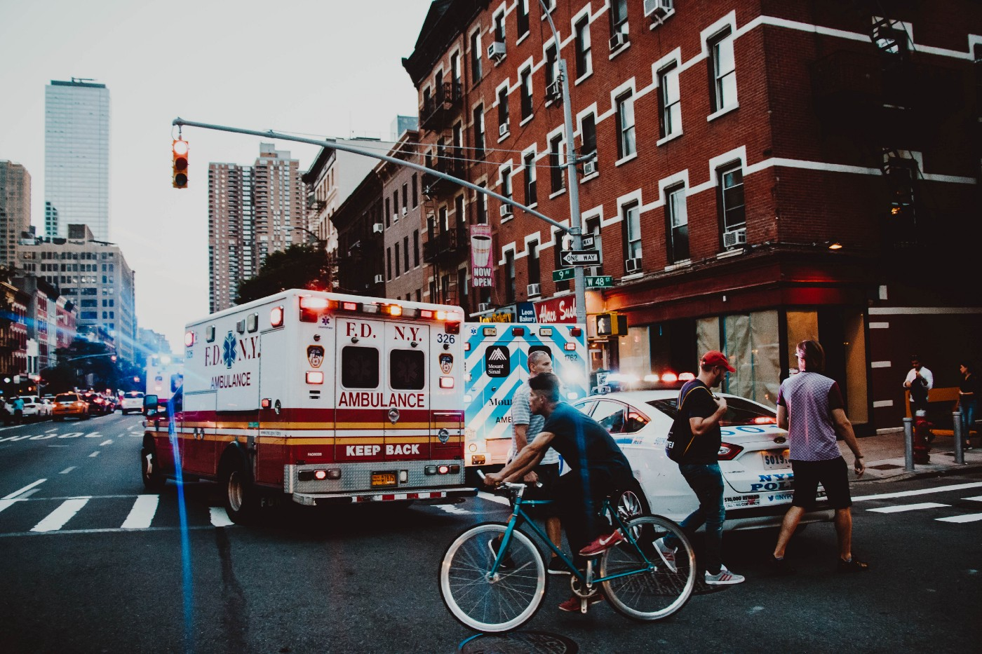 An ambulance turns through a New York City intersection.