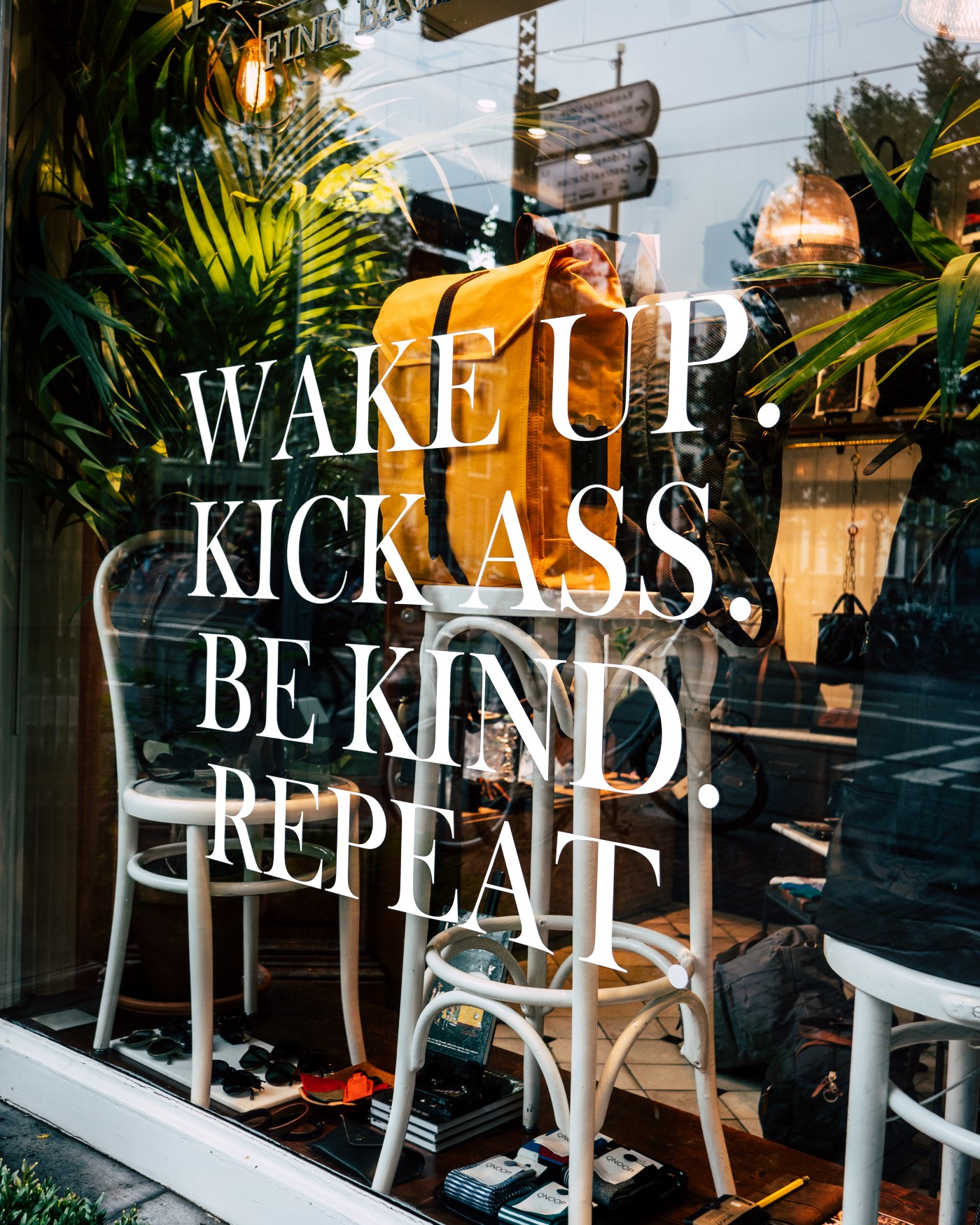 "A shop window that reads, ""Wake up. Kick ass. Be kind. Repeat."""