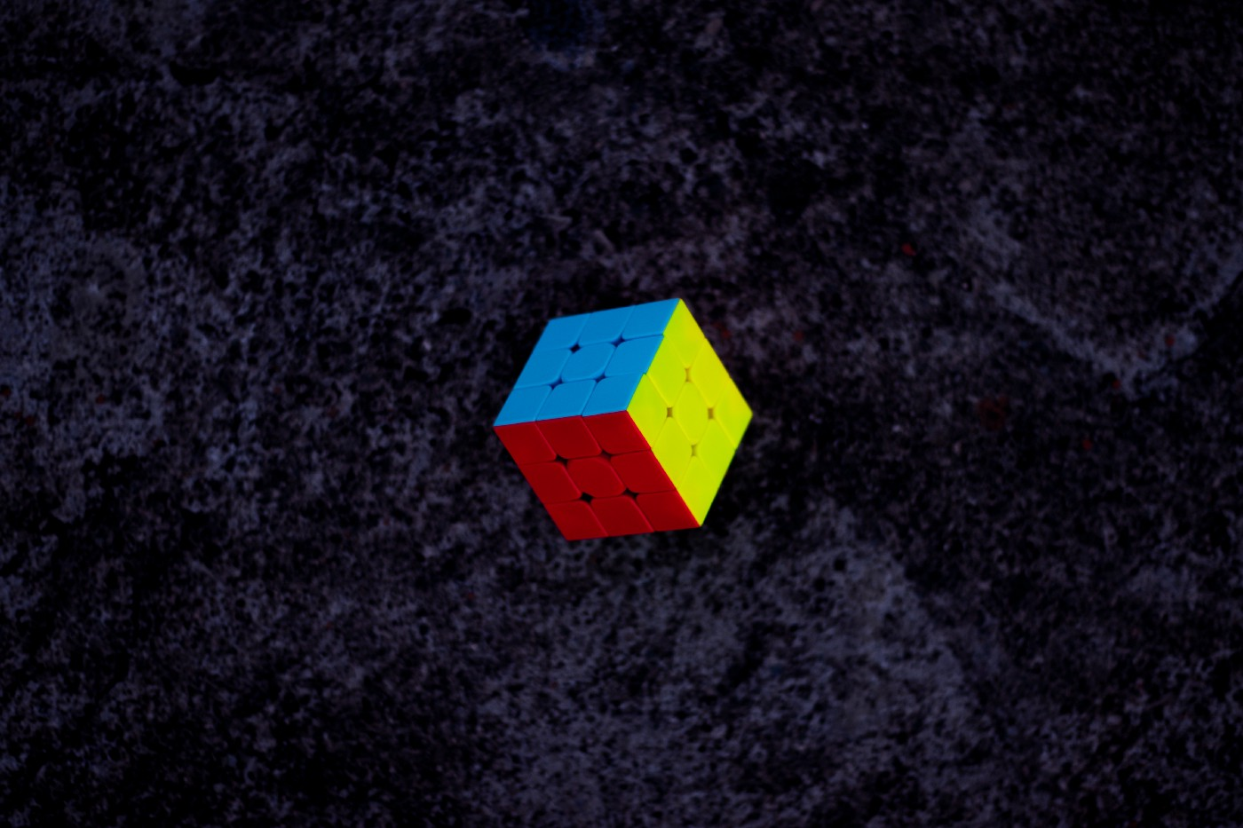 Rubic's cube floating against a black background