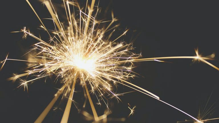 Sparklers shine as we set New Years Resolutions that will both burn out.
