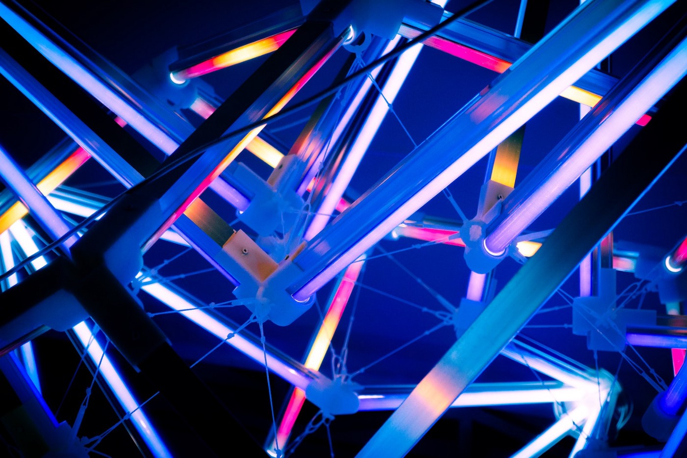 An abstract glowing line pattern created by pipes and spokes