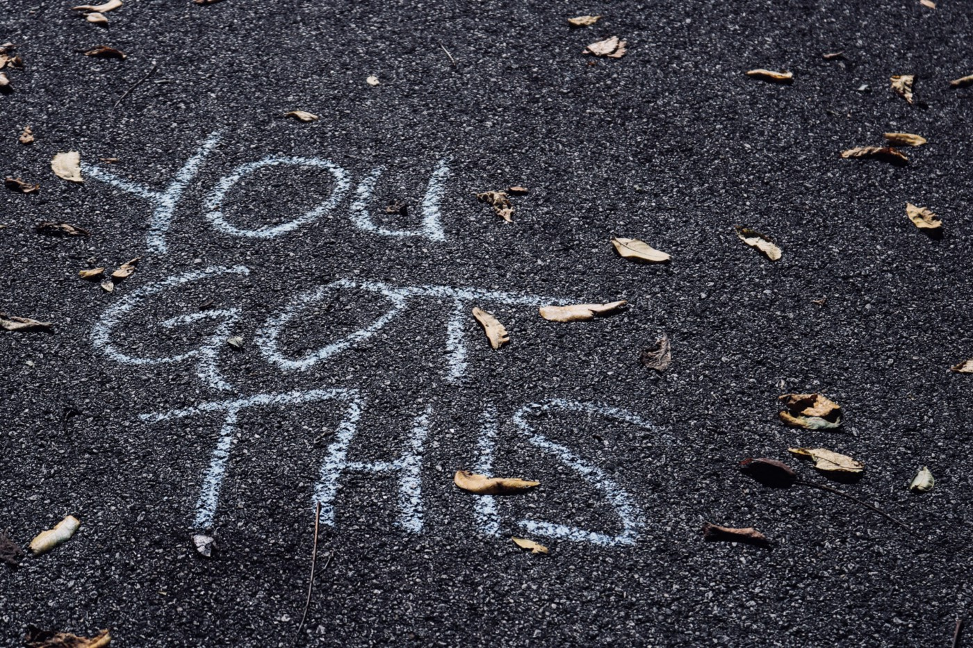"""""""You Got This"""" Written in chalk on the road."""