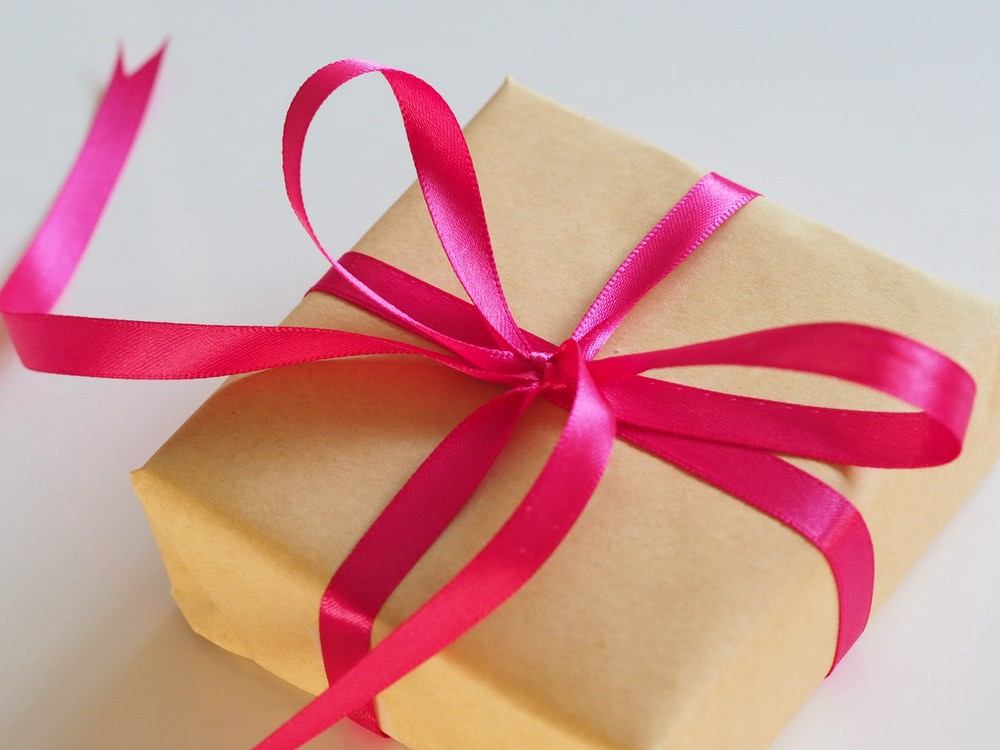 Photo of a wrapped package with a bow on it.