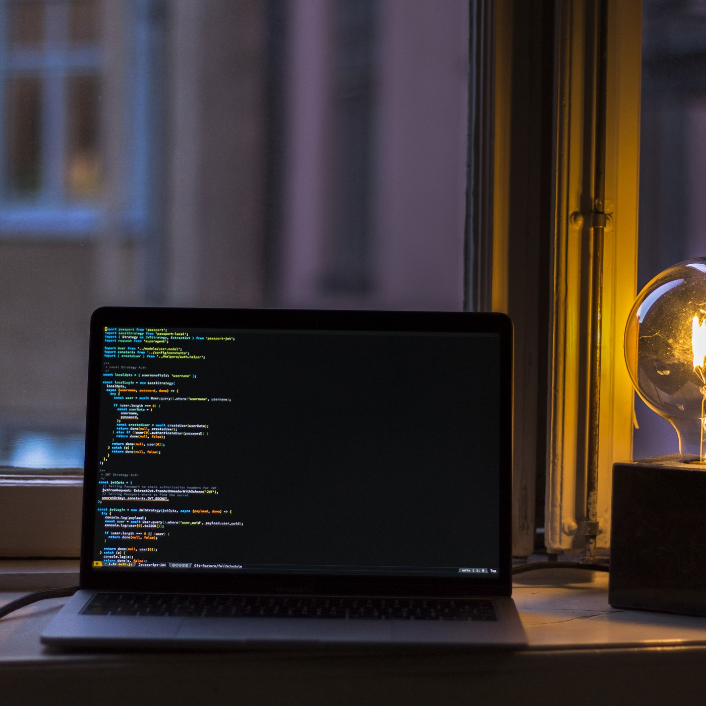 A MacBook and a lamp