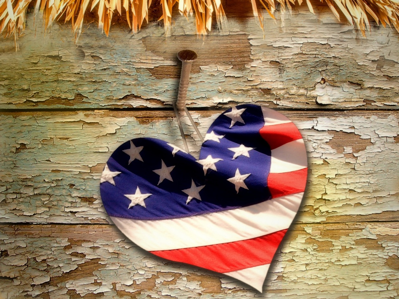 Red Voters: When hate from the left is loud, love must be louder. American flag heart with straw. Image by kalhh on Pixabay.