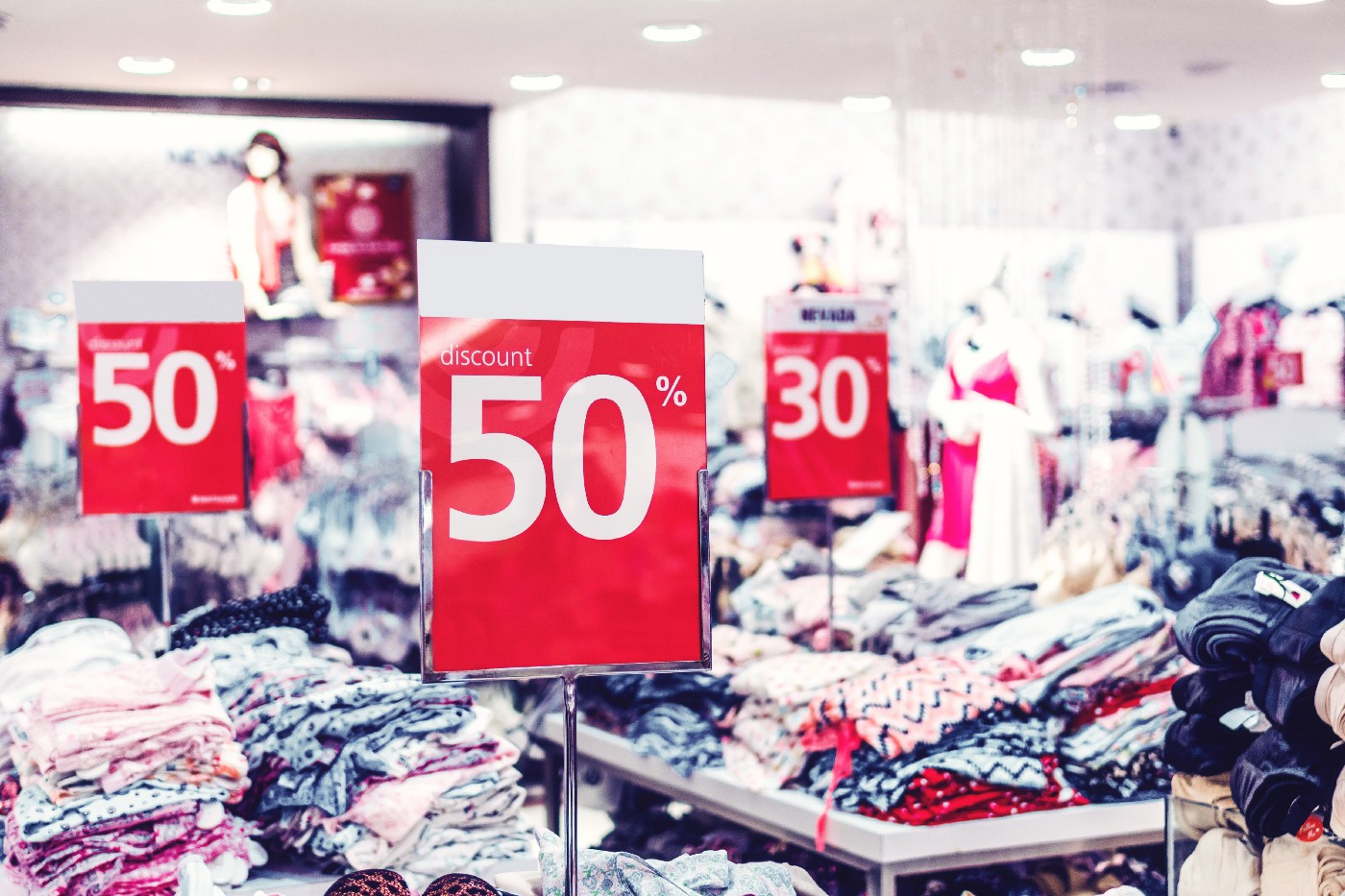 a clothing store with sale signs