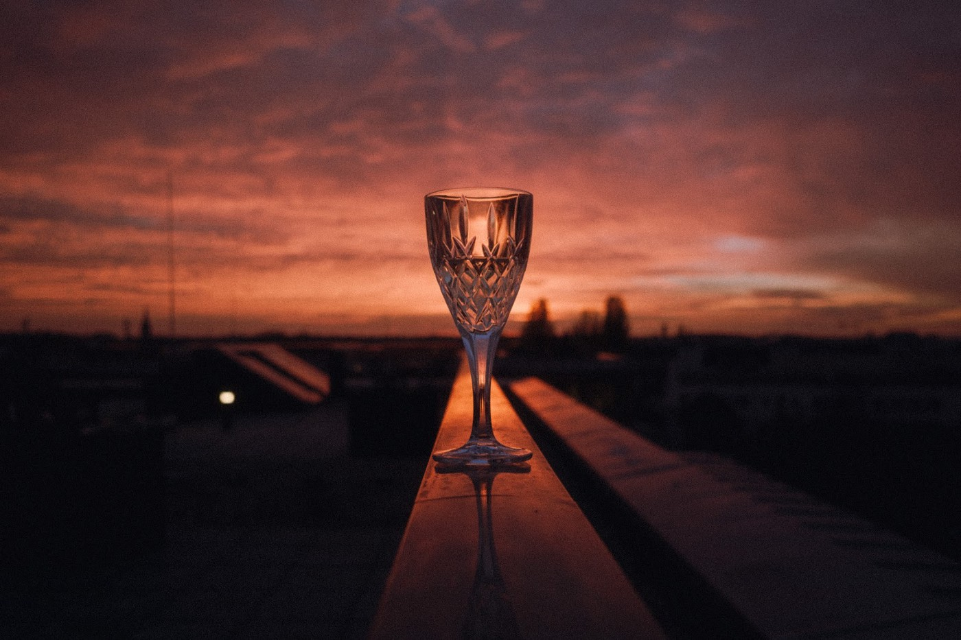 goblet with a red sunset background